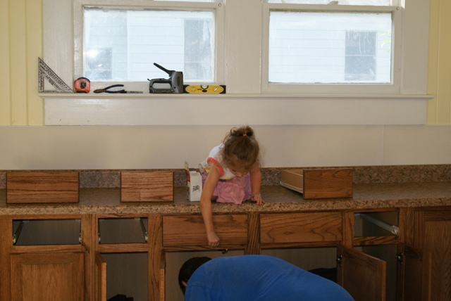Vivian helping daddy install the countertops
